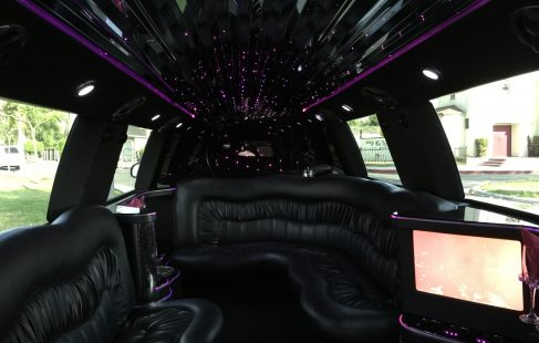 2007 black 140-inch stretch cadillac escalade limo j-seating