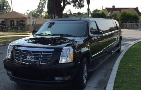 2007 black 140-inch stretch cadillac escalade limo left front