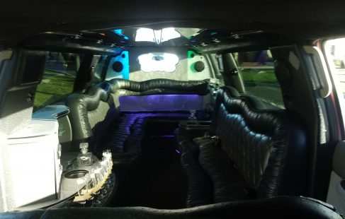 2007 pink 140-inch gmc yukon limousine interior long view