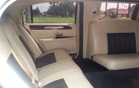 black 140-inch lincoln limo back seat right