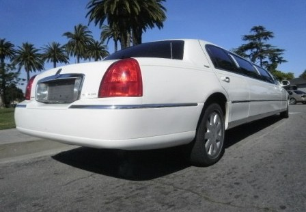 rear white lincoln town car limo