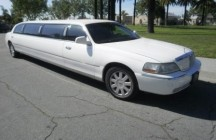 white lincoln town car limo