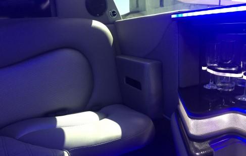 2015 black 140-inch chrysler 300 limousine close-up j-seating