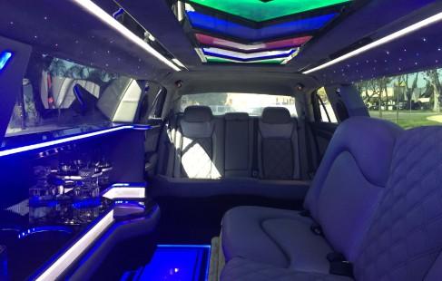 2015 black 140-inch chrysler 300 limousine facing rear