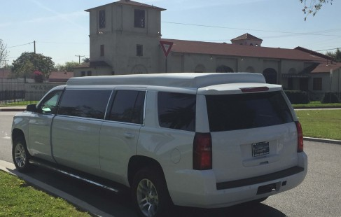 2015 white chevy tahoe 70-inch stretch suv limousine left rear