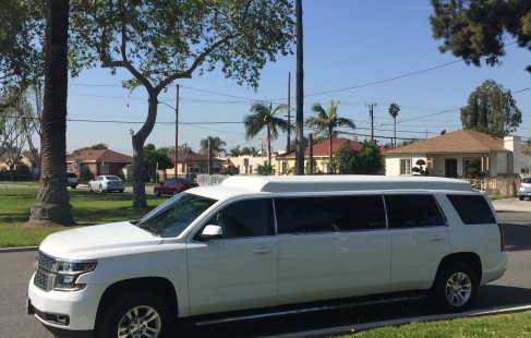2015 white chevy tahoe 70-inch stretch suv limousine left side