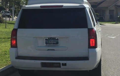2015 white chevy tahoe 70-inch stretch suv limousine rear