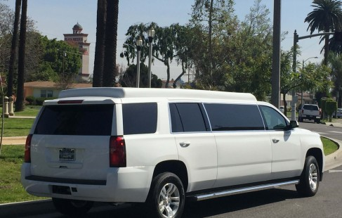2015 white chevy tahoe 70-inch stretch suv limousine right rear