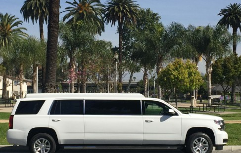2015 white chevy tahoe 70-inch stretch suvlimousine right side