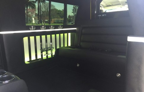 white chevy tahoe 70-inch stretch suv limousine interior