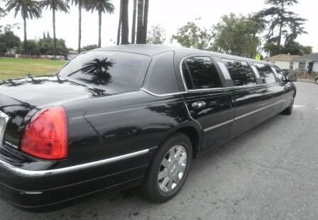 black 120-inch lincoln town car limousine right rear
