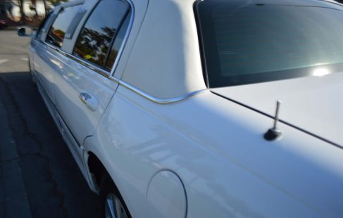 2004 lincoln town car limousine white 70-inch #673 left rear