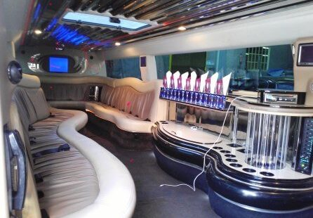 2006 white 200-inch coastal hummer h2 limousine for sale right side view