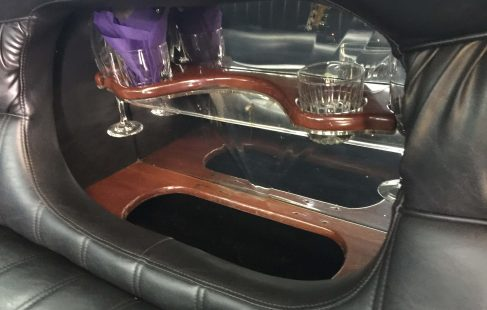 "pearl white 200"" cadillac escalade limo bar in seat"
