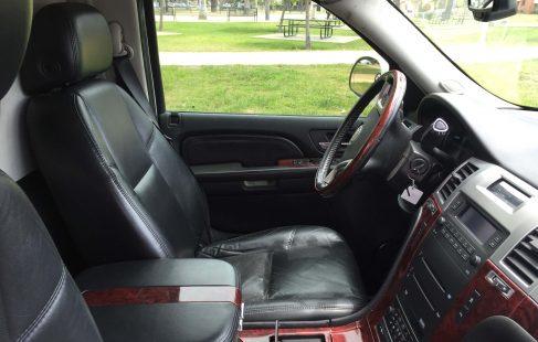 "pearl white 200"" cadillac escalade limo driver seat"