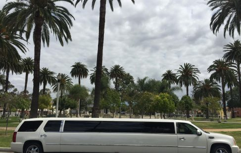 "pearl white 200"" cadillac escalade limousine right side"