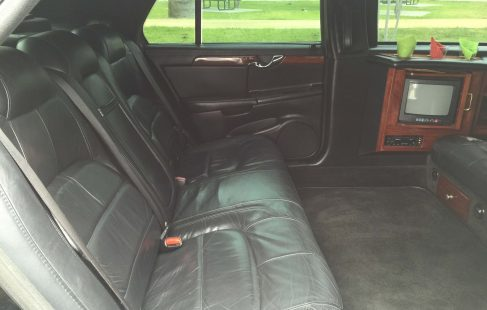 black 72-inch cadillac deville limousine for sale bench seating