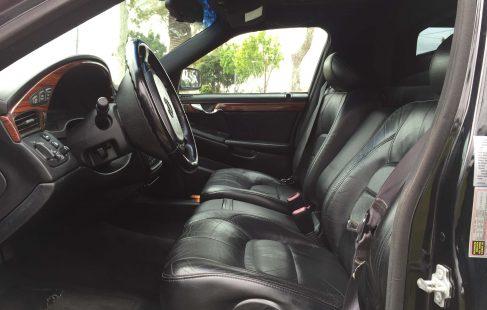 black 72-inch cadillac deville limousine for sale driver seat