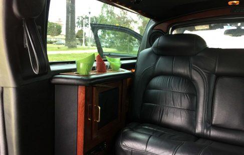 black 72-inch cadillac deville limousine for sale looking front left side
