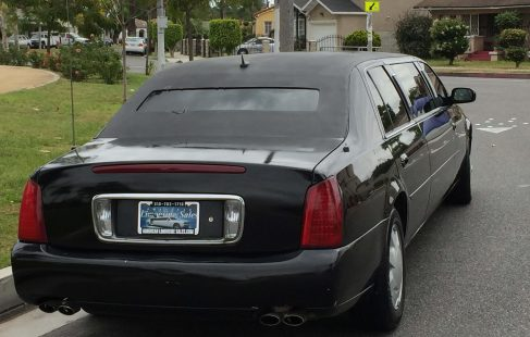black 72-inch cadillac deville limousine for sale rear