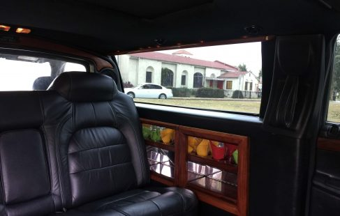 black 72-inch cadillac deville limousine for sale right side bar