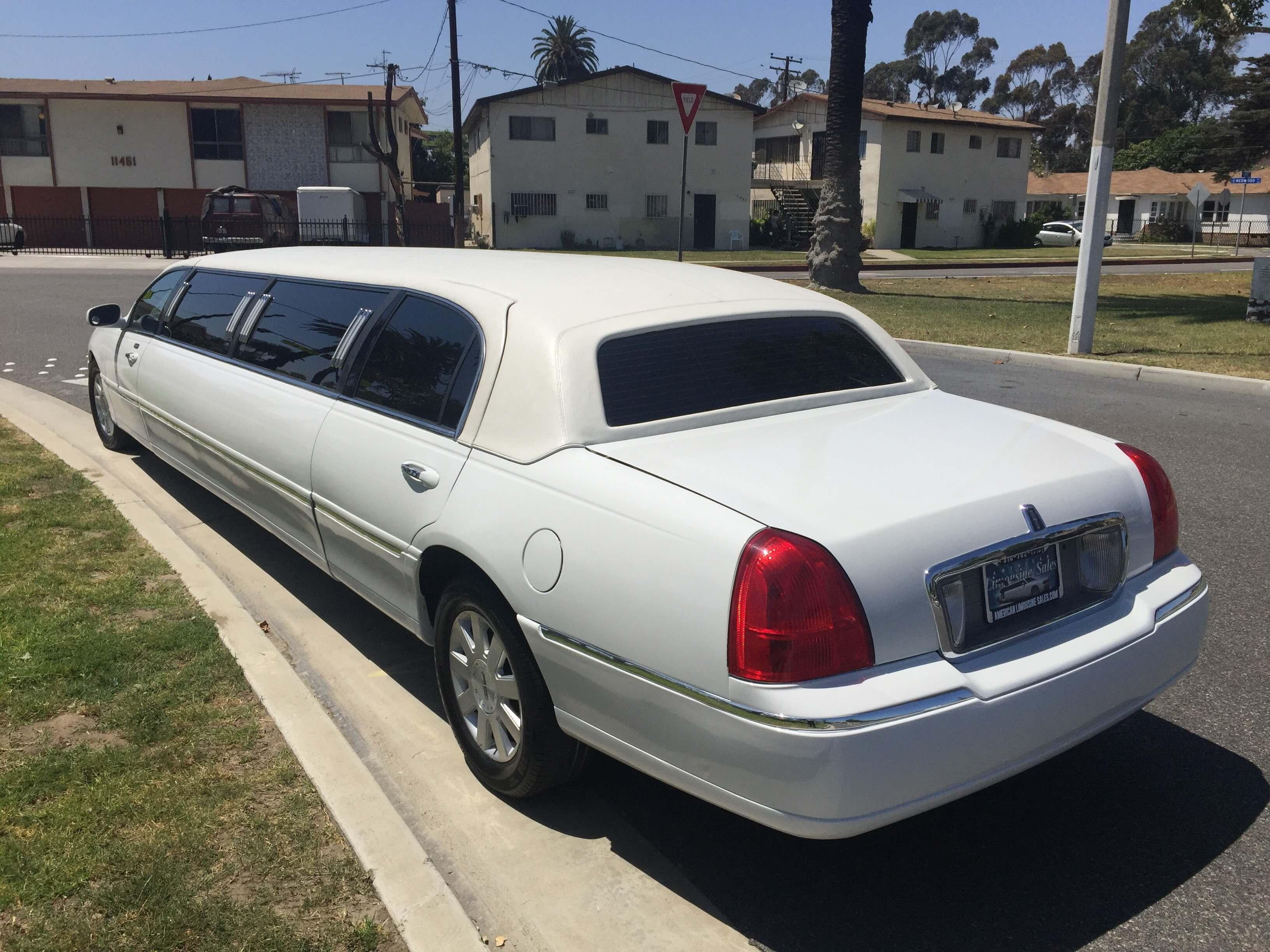 2004 white 120 inch lincoln towncar limousine for sale left rear