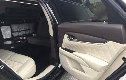 black 70-inch cadillac xts limousine right side door
