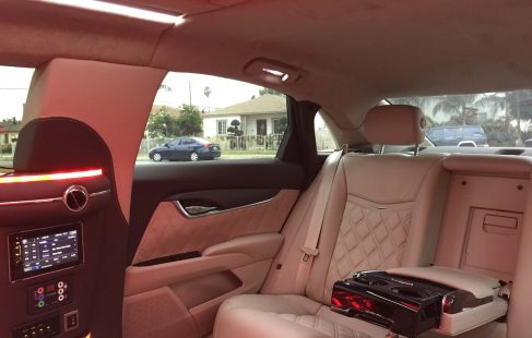 black 70-inch cadillac xts limousine rear seating