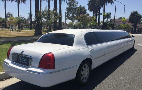 white 180-inch lincoln town car limousine
