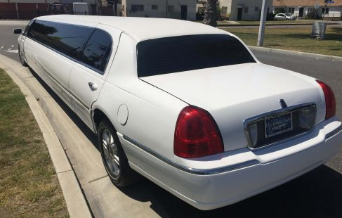 white 180-inch lincoln town car limousine left rear