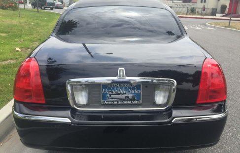2007 black 72-inch lincoln town car limousine rear