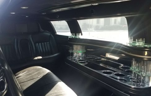 2008 black 120-inch lincoln town car limo right side full bar