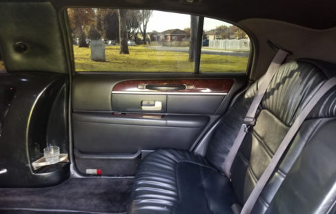 drivers side rear door showing rear bench seat of 2010 lincoln limousine
