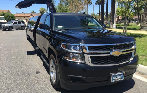 black 220 chevy suburban jet door limousine for sale